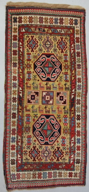 "3'2"" x 7'3"" Nw. Persian/S Caucasian rug. Good graphic design, nice color. Worn flat in areas with about 5""x5"" of the yellow ground re-knotted mid field, original ends and sides. Pretty &  ..."