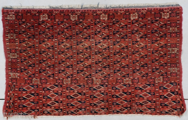 """#7415 Chuval  This mid 19th century or earlier Tekke Chuval measures 4'0"""" x 2'5"""" (121 x 76 cm). This is an exceedingly interesting piece. The big size of the skirt actually makes this  ..."""
