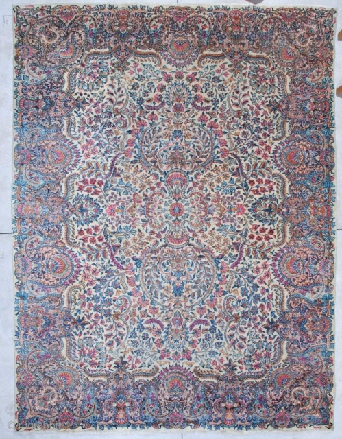 """#6970 Antique Laver Kerman Rug  This circa 1920 Laver Kerman Persian Oriental rug measures 8'9"""" X 11'7"""".  It has a very busy over all design with a small medallion which practically  ..."""