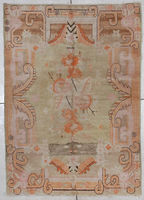 """#7064 Antique Khotan Carpet  This circa 1920 Khotan carpet measures 4'8"""" x 6'7"""".  It has a pale lime green field with orange, pink and brown flowers in the center.  The  ..."""