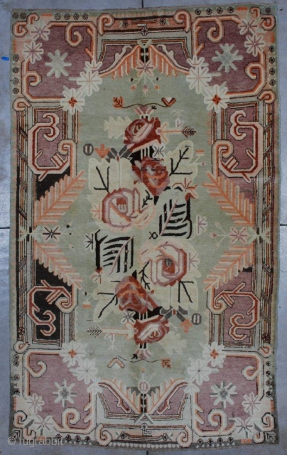 """#7089 Antique Khotan Rug 5'5″ X 8'10"""" This circa 1920 Khotan carpet measures 5'5″ x 8'10″"""".  It has a pale lime green field with orange, pink and brown flowers in the center.  ..."""