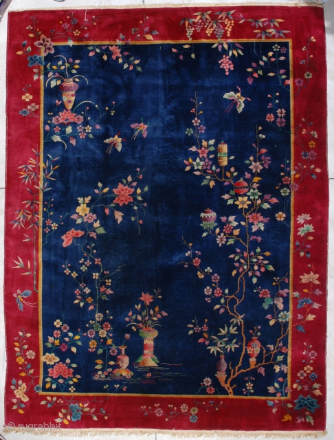 """#7133 Antique Art Deco Chinese Rug 8'9″ x 11'8″ This circa 1920 Art Deco Chinese Oriental carpet measures 8'9"""" X 11'8"""". It has a uni-directional floral design with a very interesting twist…some of  ..."""