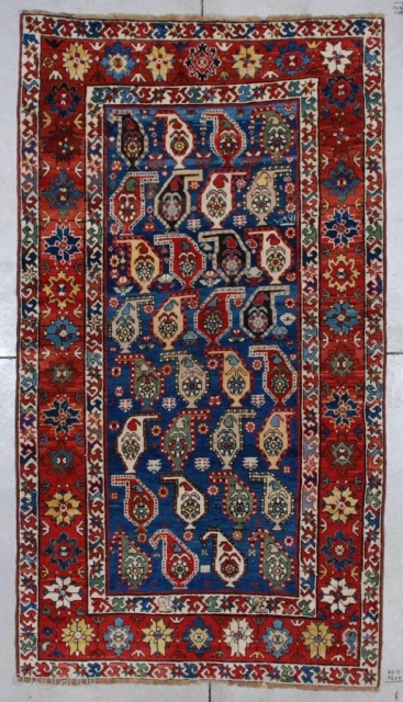 """#7055 Kazak Antique Caucasian Rug  This Kazak measures 4'2"""" X 7'5"""". It is dated 1870 and there is no reason in the world to doubt it. The central motif are botehs in  ..."""