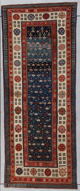 """#7188 Talish Antique Caucasian Rug This circa 1880 antique Talish antique Oriental Rug measures 3'5"""" X 8'10' (104 x 203 cm). It has a blue field with a multicolored triangle motif.    ..."""