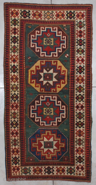 "#7198 Kazak Antique Caucasian Rug  This third-quarter 19th-century Kazak measures 4'2"" X 8'5"" (128 x 259cm). It has four memling gul medallions, one on a blue ground, one on an aubergine ground,  ..."