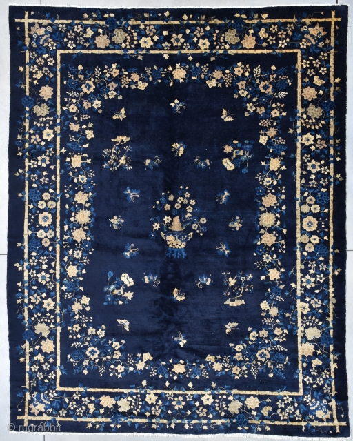 """Antique Peking Chinese Oriental Rug 9'2"""" X 11'7"""" #7945 This circa 1900 Peking Chinese Oriental rug measures 9'2"""" X 11'7"""". It has a deep indigo background. The motif has a planted pot of  ..."""