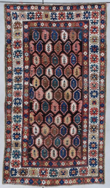 """#7320 Kazak Antique Caucasian Rug 4'4″ x 7'6″ This circa 1890 Caucasian Kazakh carpet measures 4'4"""" x 7'6"""" (134 x 231 CM). It is multicolored on an abrashed brown field with lots of  ..."""