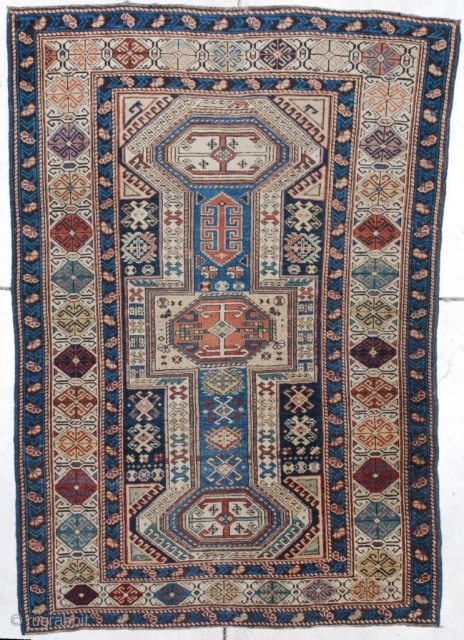 "#7241 Shirvan Antique Caucasian Rug This circa 1875 keyhole design Shirvan antique Oriental Rug measures 3'7"" x 5'3"". It has a dark blue ground with ivory keyhole center motif. It has three  ..."