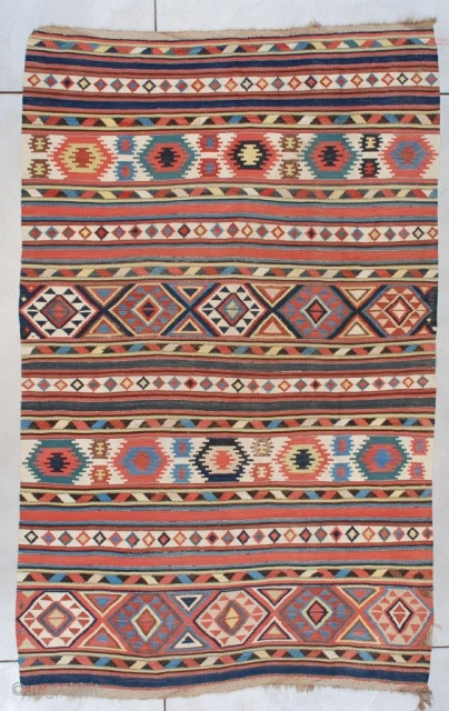 """This 19th century Caucasian (Shirvan) Kilim measures 5'11"""" x 9'6"""" (179 x 292 cm). It is a beautifully drawn Caucasian kilim in striped motif with Memling guls, diamonds, triangles, stripes and solid  ..."""