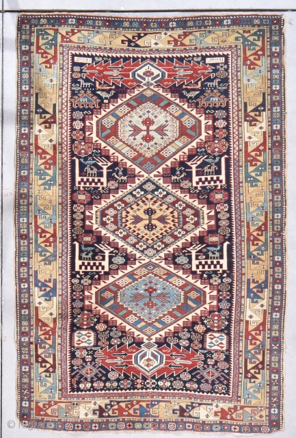 """Antique Shirvan Rug 3'10"""" X 5'10"""" #7861 This antique Shirvan Oriental Rug dated 1900 measures 3'10"""" X 5'10"""". It has three medallions. The top and bottom medallions are in a pale blue and  ..."""