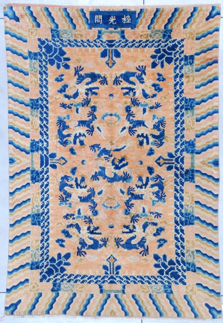 """This Ningxia Chinese Oriental rug measures 6'3"""" X 9'2"""". It has 9 five toed dragons in blue on an orange gold ground. Sacred mountain meditation points quarter the rug and are in  ..."""