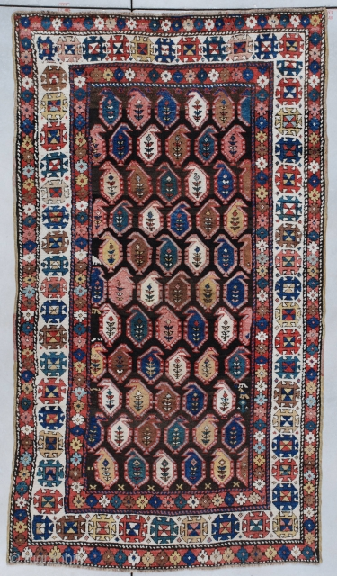 "This circa 1890 Caucasian Kazakh #7320 carpet measures 4'4"" x 7'6"" (134 x 231 CM). It is multicolored on an abrashed brown field with lots of cute little asymmetric surprises in the  ..."