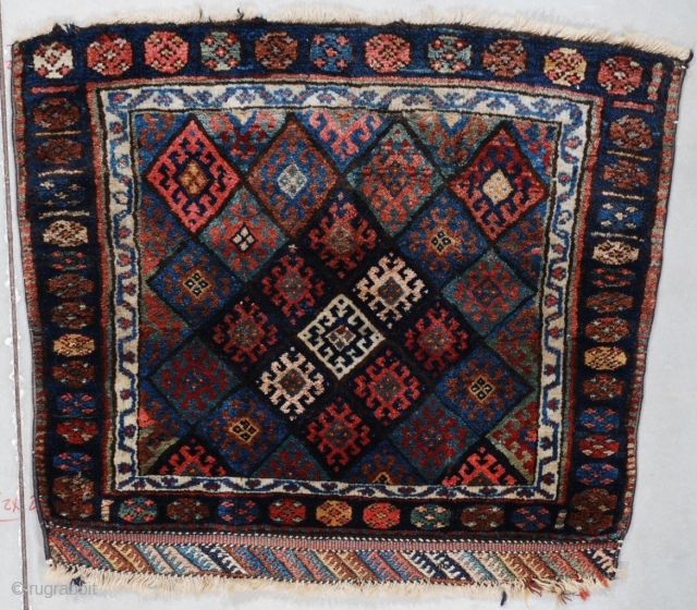 "This last quarter 19th century antique Jaf Kurd Oriental Rug measures 2'8"" X 3'0"" (85 x 91 cm). It has a field filled with typical Jaf Kurd diamonds with a row of  ..."
