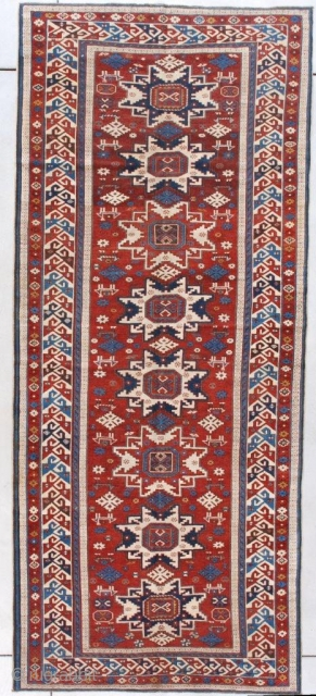 """Lesghi Shirvan Antique Caucasian Runner #7624 This late 19th century Lesghi Shirvan Long Rug Oriental Carpet measures 4'1"""" X 9'5"""" (125 x 289 cm). It has the rare and very heavenly red ground  ..."""