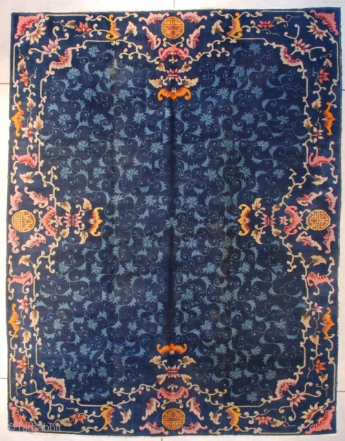 "This circa 1930 Art Deco Chinese Rug #7665 measures 8'11"" X 11'8""(273 x 359 cm). It is a dark blue Chinese rug with an overall field design of leaves and flowers in  ..."