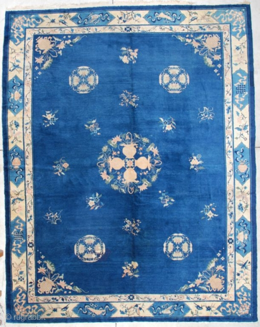 """#7165 Peking Chinese Rug  This Peking Chinese rug measures 9'2"""" X 11'8"""". It has a medium blue field with a central medallion of four flowering urns coming together to form a wreath with  ..."""