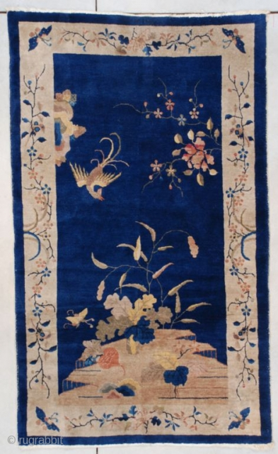 "#7474 This circa 1925 Art Deco Chinese Oriental Rug measures 4'2"" x 6'9"". The bottom of the rug contains a rockery with several types of flora and butterflies flitting about. There is  ..."