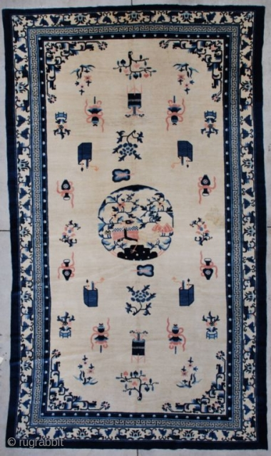"""7263 Peking Chinese Rug  This circa 1900 Peking Chinese Oriental carpet measures 7'2"""" X 12'1"""". It has an ivory field containing various Buddhist iconographies including the beribboned umbrella, paint boxes, standing urns, and  ..."""
