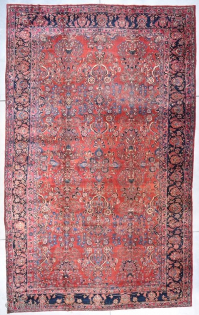 """#7763 Sarouk  This circa 1920 palace size Sarouk measures 11'0"""" X 17'10"""" . It has a maroon colored field with an all over design and a small center medallion. The major border has  ..."""