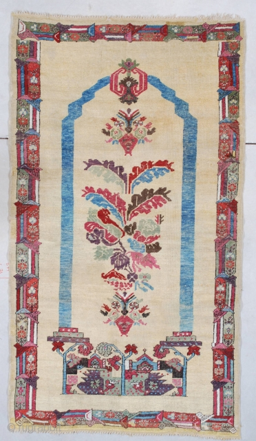 """#7520 Antique Ghiordes Rug  This circa 1850 Ghordez measures 3'6"""" X 6'3"""" (109 x 192 cm). This extremely interesting Ghordez is woven in a coupled column motif with a tree of life motif  ..."""