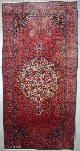 """#7531 Kashan   This circa 1920 Kashan measures 9'6"""" X 19'10"""" (292 x 609). This carpet of unbelievable quality is woven with Manchester wool. It has a large pulled medallion filled with a  ..."""