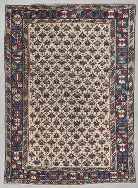 """#7742 Kuba  This antique Kuba Oriental Rug measures 3'8"""" X 5'1"""" (116 x 155 cm). It has an ivory ground completely covered in a combination of shield and palm head design with multi  ..."""