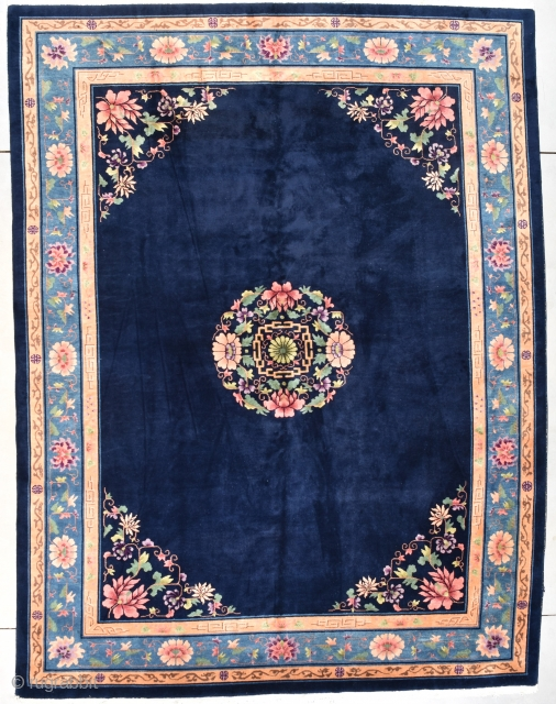 """#7728 Nichols Art Deco Chinese Oriental Rug  This circa 1925 Art Deco Chinese Oriental Rug signed NICHOLS measures 9'0"""" X 11'11"""" (274 x 368 cm). It has a large floral medallion in pink,  ..."""