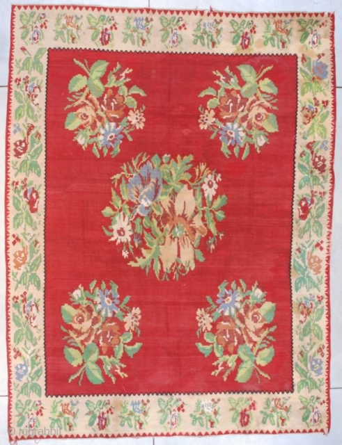 """#7601 Bessarabian Kilim  This circa 1930 Bessarabian Kilim measures 8'7"""" X 11'3"""" (265 x 344 cm). It has a tomato red ground with five huge bouquets of flowers in green, Wedgewood blue, cordovan  ..."""