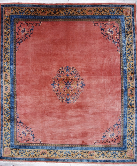 """#7162 Peking Chinese Rug This circa 1910 Peking Chinese rug measures 11'1"""" X 12'9"""". It has a medallion in a circle with vines in blue, ivory, and pale brown to gold. It has  ..."""