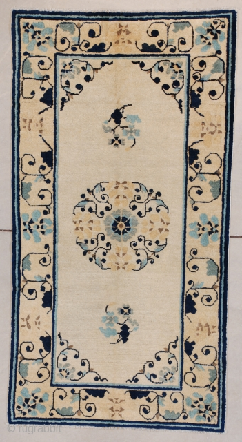 """#7620 Peking Chinese rug This circa 1890 Peking Chinese rug measures 2'9' X 5'2"""" (90 x 158 cm). It has a floral medallion in a wreath shape flanked by two sprigs of flowers.  ..."""