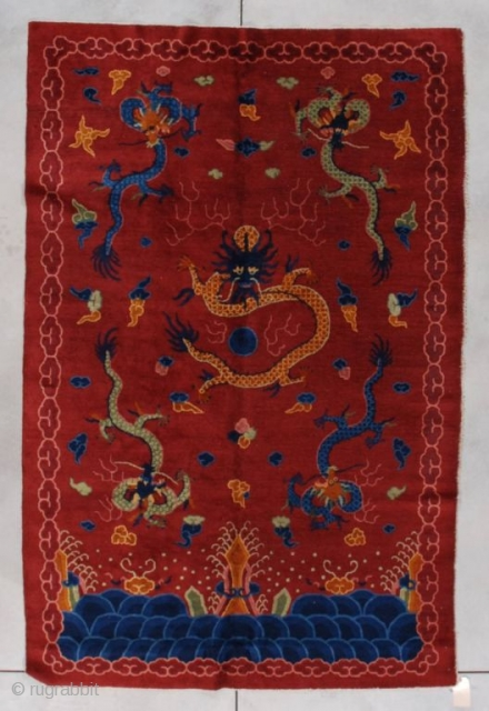 "This circa 1910 Peking Chinese Oriental rug measures 5'1"" X 7'9"". It has a very deep rust to brick red field containing five dragons. There is one in each corner in blue  ..."