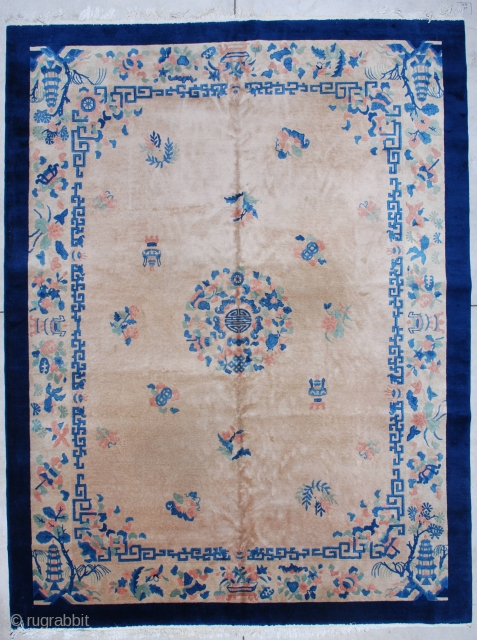 "http://www.antiqueorientalrugs.com/Rchinese3.htm This circa 1930 Art Deco Chinese Oriental rug measures 9'0"" X 11'8"". It has a light café au lait field with a center medallion containing the symbol for Shui for good  ..."