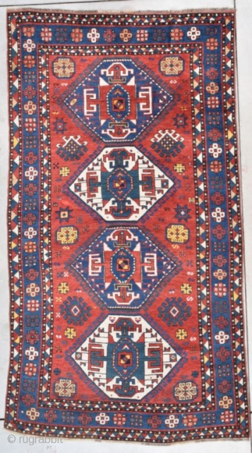 """This second half 19th century Kazak measures 4'7"""" X 8'4"""" (143 x 256 cm). This is a splendid Kazak. The tomato red ground sports four medallions in green and ivory. The medallions  ..."""