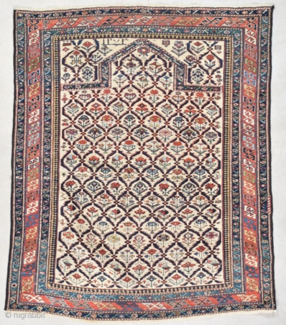 """#7559 Marasali Shirvan  This dated 1852 Marasali Shirvan measures 3'7"""" X 4'4"""" (112 x 134 cm). It has a lattice design on an ivory ground. Each lattice opening contains a flower. Most  ..."""