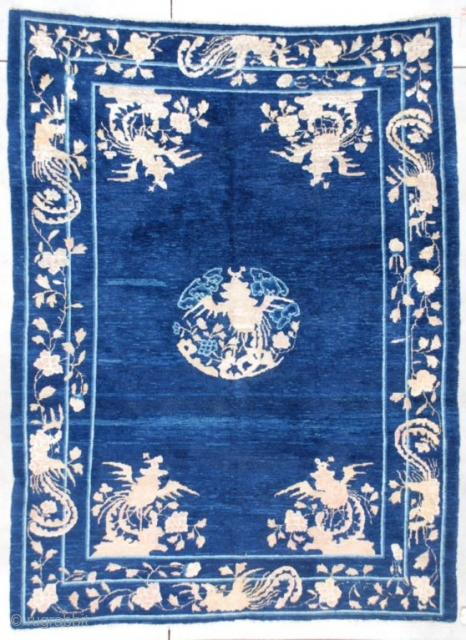 """#7328 Peking Chinese Rug This late 19th century Peking Chinese Oriental Rug measures 6'4"""" X 8'5"""". It has a dark blue variegated field with a corner motif of phoenix birds perched in a  ..."""