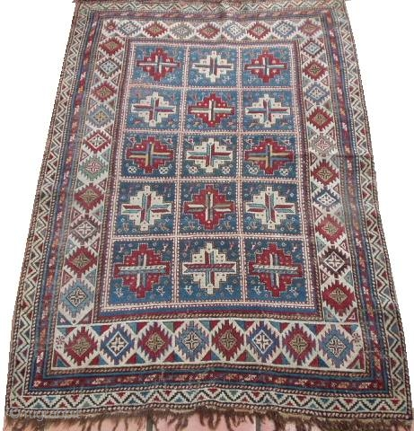 #6423 Shirvan Antique Caucasian Rug This Shirvan antique Oriental rug measures 4'0' X 6'0'. It has fifteen panels with red and white medallions containing cross bars of ivory/blue , ivory/red , ivory/green ,  ...