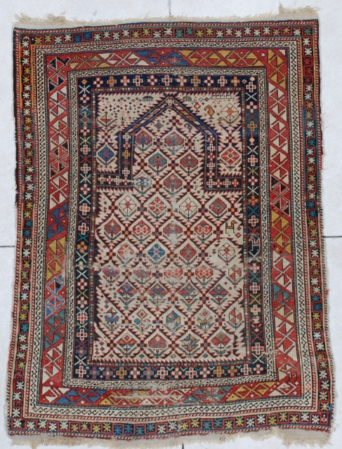 """#6611 Shirvan Antique Caucasian Rug  This antique Shirvan Oriental area rug dated 1818 measures 3'6"""" X 4'10"""". It is an extremely early dated Shirvan prayer rug. It has an ivory field with  ..."""