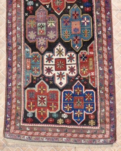An Artsakh Karabagh long rug,( Nagorno Karabagh)  312 x  102 cm. Late 19th. century.   Dark chocolate brown ground with shield design with soft pastel tones: aquamarine, mauve, ocre, sea-green.  ...