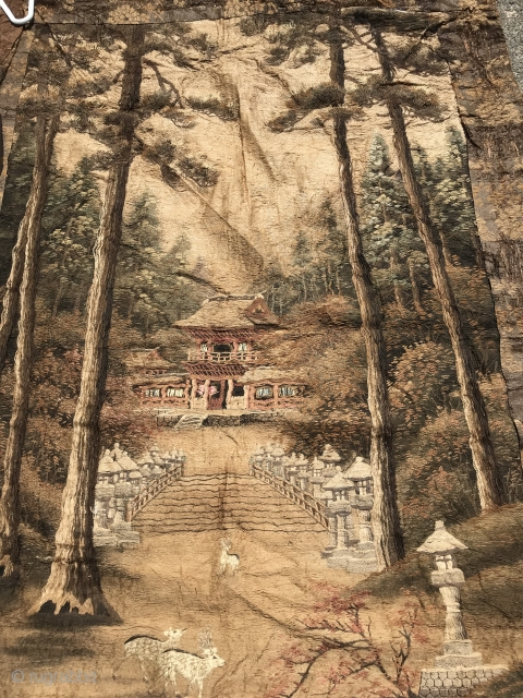 """Japanese Embroidered Wall Hanging Silk hand embroidery of pine forest and pagoda with two deer in foreground on hand-woven with supplemental weft background. 5"""" hand-woven geometric border. Orange brown brocaded floral and vine  ..."""