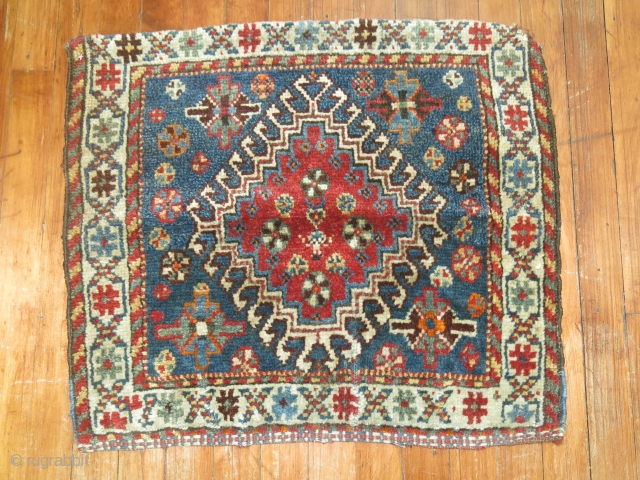 Antique ghasgai bagface.  Top end is sewn on back and missing a little.  Size is 2'2''x1'10''