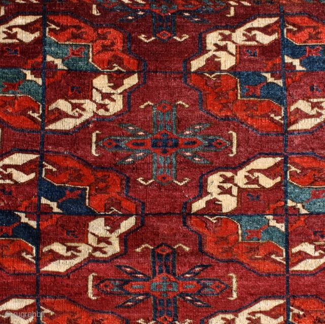 """Tekke main carpet with tucked gul's. Lost one row of gulls and pepper'd with treated moth damage. Circa 1800. Size 6'3"""" x 7'2""""."""