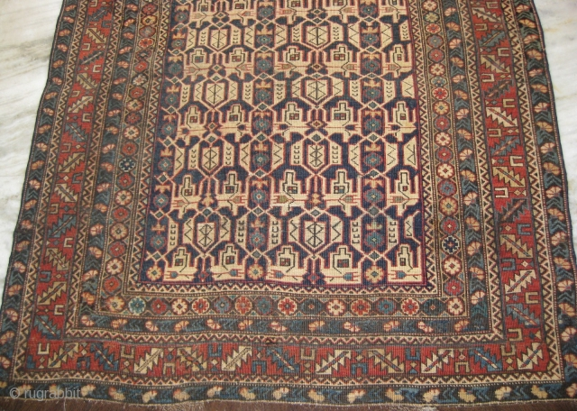 An old Caucasian rug 4.10 x 3.9 feet, repaired and consistent wear throughout.