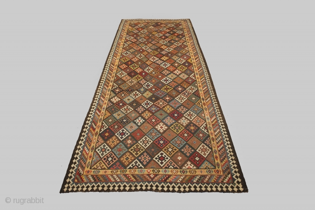 12941 Antique Bakhtiar Kilim 528x215cm Circa 1900  Magnificent antique Bakhtiar kilim. Multi coloured lozenge ground encased in a three layered border. Bakhtiar region is known for its use of natural dyes in its  ...