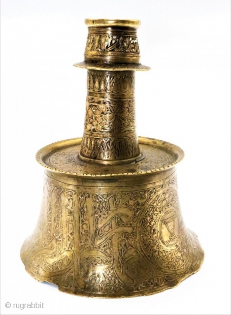 Ab extremely rare mamluk silver inlaid calligraphic brass candlestick an extremely rare islamic early mamluk calligraphic brass & silver inlaid brass candlestick, Egypt, circa 13TH/14th century. base of waisted form leading to  ...