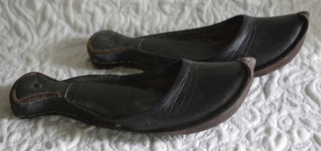 Misc 175  This antique pair of Hand made leather are the old traditional shoes which were worn in Turkey. They were called Charoog...spelling may vary. The soles are concave and curl to  ...