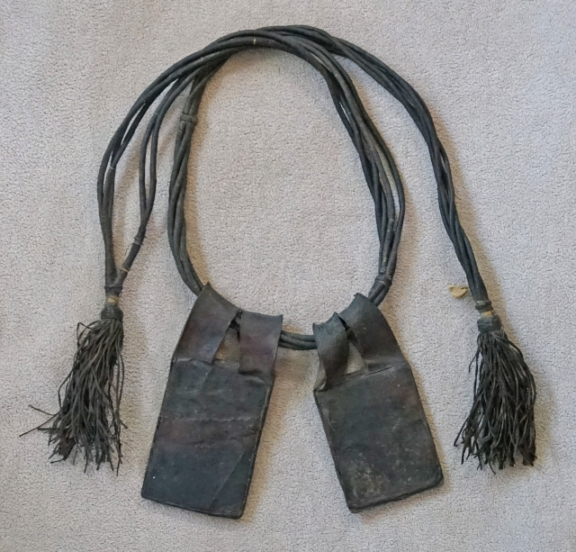 This Antique leather Tuareg belt with hanging talismans, is from the African region of Timbuktu, Mali. Including the fringe, the total length is roughly 46 inches. The leather talisman are flat. They  ...