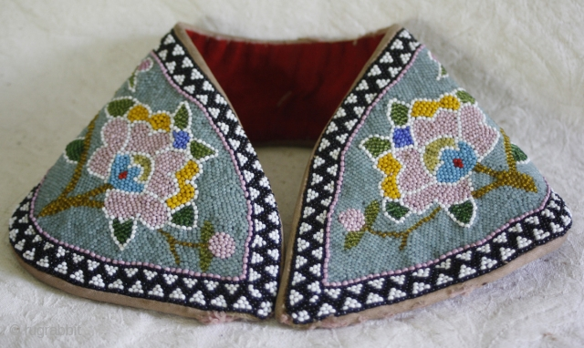 TC394  This antique beaded headband is from Guang Dong province in China, and is typical of headgear worn by Chinese woman around the turn of the 19th-20th century. It would have  ...