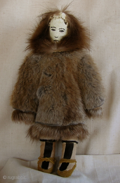 Misc110 Large Old Female Inuit Eskimo Doll All hand-sewn Eskimo doll probably made sometime during the 60's. She is dressed in nicely detailed fur parka with fox trimmed hood and has hand-painted facial  ...