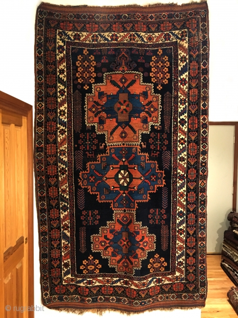 Afshar Long Rug. Circa 1900. Four different distinct borders enclose the classic flower center stepped medallions with one vase at top of field. Heavy structure type with thick pile. Great condition. Original  ...
