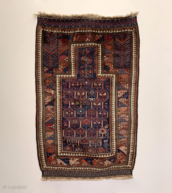 A rare and spectacularly colored Timuri Prayer Rug dating to the Mid 19th Century. Please note the use of color, specifically steel blue, peach, and purple. The honeycomb field is enclosed by  ...